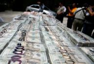 FILE PHOTO: Packages of money seized during an operation are shown to the media at a military zone on the outskirts of Monterrey