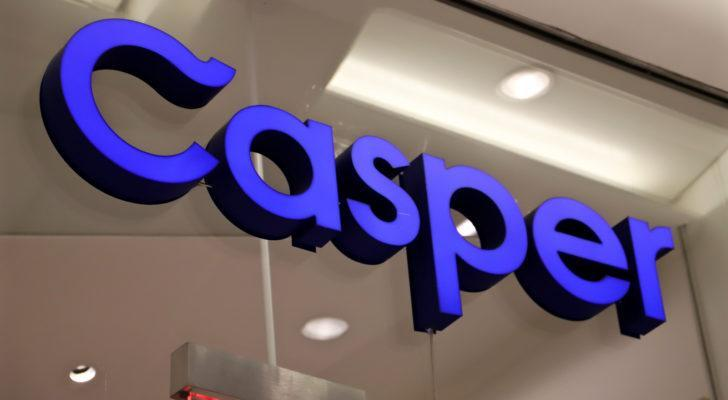 A bright purple sign for Casper Sleep (CSPR) hanging on a glass wall.
