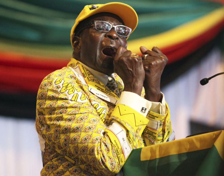 """Zimbabwean President Robert Mugabe clenches his fists as he delivers his speech at his party's 13th annual conference, in Gweru about 250 Kilometres south west of the capital Harare, Friday, Dec. 7, 2012 .Zimbabwe president's loyalists have converged for an annual party convention in the provincial city of Gweru, hoping to map out a winning election strategy to end a conflict-ridden four-year-old coalition. President Robert Mugabe said in the state media Friday the convention should prepare for a convincing victory """"that will leave no room for doubt."""" The longtime leader has said he wants elections in March, a target that doesn't seem realistic. (AP Photo/Tsvangirayi Mukwazhi)"""