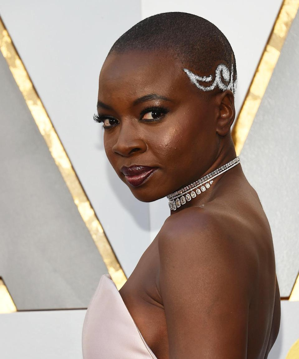 "<strong>Danai Gurira, 2018</strong><br><br>Between her roles on <em>The Walking Dead</em> and <em>Black Panther</em>, fans know Danai Gurira as an on-screen badass. The star carried that symbol of strength straight to the Oscars red carpet last year when wearing a <a href=""https://www.refinery29.com/en-us/2018/03/192518/danai-gurira-oscars-hairstyle-meaning"" rel=""nofollow noopener"" target=""_blank"" data-ylk=""slk:meaningful style"" class=""link rapid-noclick-resp"">meaningful style</a> created by <a href=""https://www.instagram.com/byvernonscott/"" rel=""nofollow noopener"" target=""_blank"" data-ylk=""slk:Vernon Scott"" class=""link rapid-noclick-resp"">Vernon Scott</a>, who looked to traditional, ancestral tribal African designs as his inspiration.<span class=""copyright"">Photo: VALERIE MACON/AFP/Getty Images.</span>"