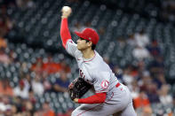 Los Angeles Angels starting pitcher Shohei Ohtani throws against the Houston Astros during the first inning of a baseball game Tuesday, May 11, 2021, in Houston. (AP Photo/Michael Wyke)