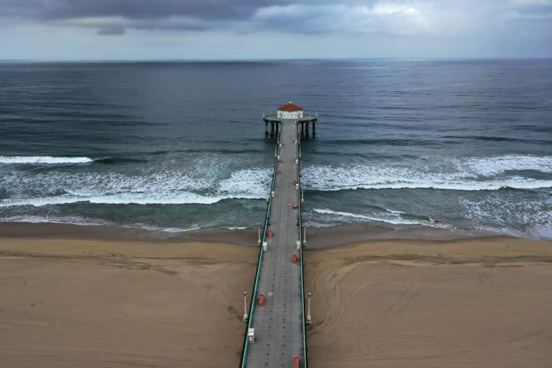 Beaches on the Pacific Ocean lie empty after Los Angeles issued a stay-at-home order and closed beaches and state parks, as the spread of the coronavirus disease (COVID-19) continues, in Manhattan Beach