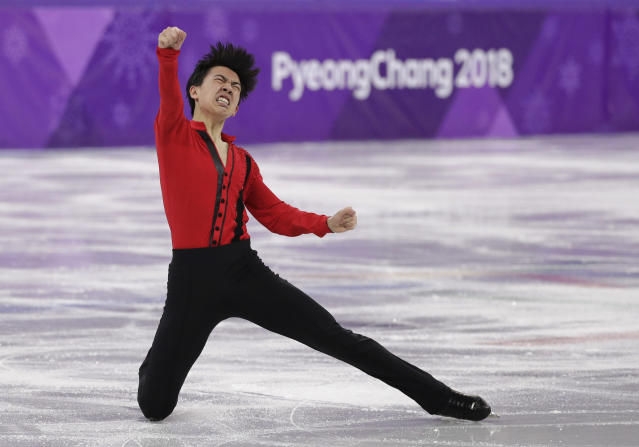 Vincent Zhou reacts following his performance in the men's free figure skating final at the 2018 Winter Olympics. (AP)