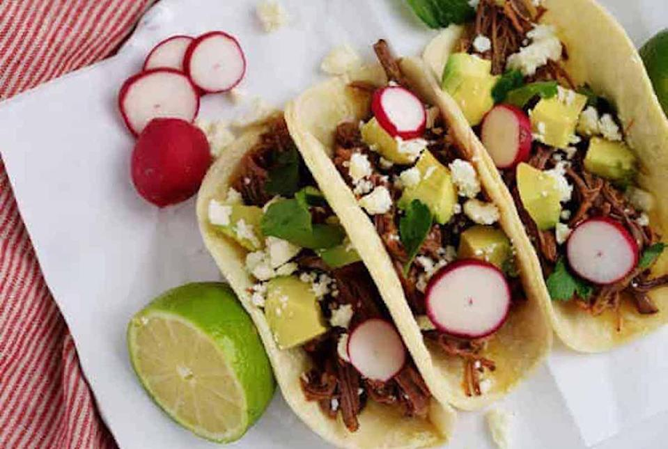 "<p>Making tacos doesn't have to be a hassle when the slow cooker does the work for you. All you need to do is add in beef brisket and a jar of green salsa and you can come home at the end of the day to dinner — this recipe couldn't be easier if you tried. Pair the brisket with tortillas and top with radishes, cheese, pickled onions, jalapenos or whatever you desire.</p> <p><a href=""https://www.thedailymeal.com/recipes/two-ingredient-slow-cooker-beef-brisket-recipe?referrer=yahoo&category=beauty_food&include_utm=1&utm_medium=referral&utm_source=yahoo&utm_campaign=feed"" rel=""nofollow noopener"" target=""_blank"" data-ylk=""slk:For the Two-Ingredient Slow Cooker Beef Brisket recipe, click here."" class=""link rapid-noclick-resp"">For the Two-Ingredient Slow Cooker Beef Brisket recipe, click here.</a></p>"
