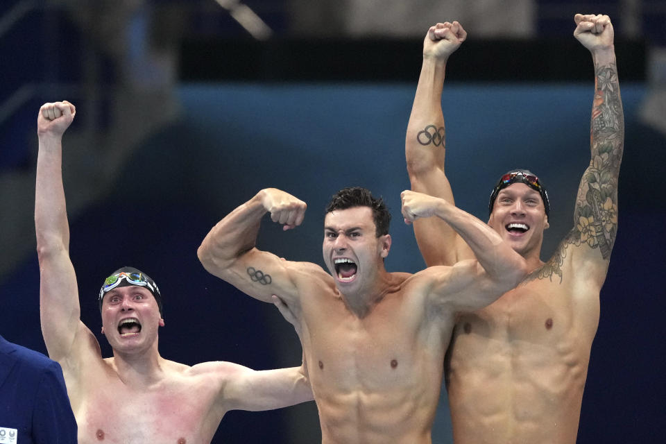 CORRECTS TO BECKER FROM BECK - United States men's 4x100m freestyle relay team Bowen Becker, Blake Pieroni, and Caeleb Dressel celebrate after winning the gold medal at the 2020 Summer Olympics, Monday, July 26, 2021, in Tokyo, Japan. (AP Photo/Matthias Schrader)