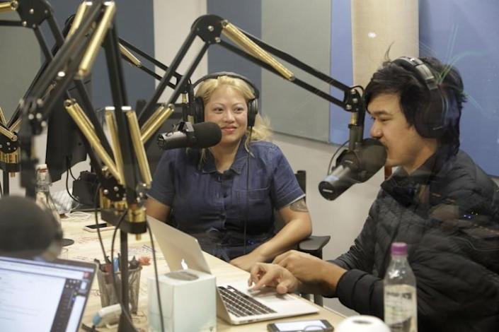 "Guest Kulap Vilaysack, left, records an episode of ""Yo, Is This Racist?"" with host Andrew Ti for comedy podcast network Earwolf in 2018. Stitcher, Earwolf's parent company, is set to be acquired by Sirius XM. <span class=""copyright"">(Myung J. Chun / Los Angeles Times)</span>"