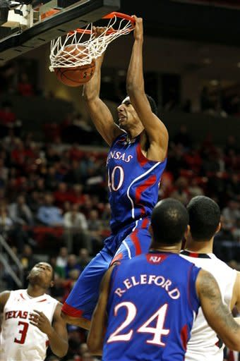 Kansas' Kevin Young scores over Texas Tech's DeShon Minnis, left, during an NCAA college basketball game at United Spirit Arena in Lubbock, Texas, Wednesday, Jan.11, 2012. (AP Photo/Lubbock Avalanche-Journal, Stephen Spillman)
