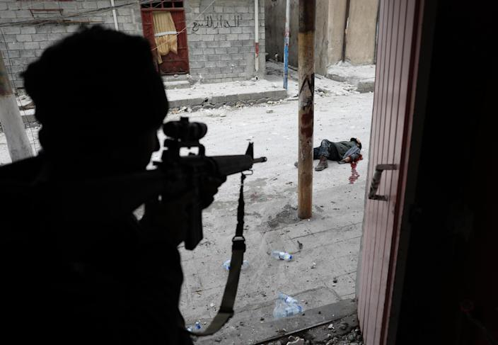 <p>Mideast crisis Iraq Mosul: An Iraqi Special Forces soldier some moments after shooting dead a suspected suicide bomber, during the offensive to retake Mosul, March 3, 2017.<br>The battle to reclaim Mosul from ISIS began in October 2016 and lasted until July 2017, with fighting against pockets of ISIS militants continuing in some quarters of the city even beyond that date. The use of suicide bombers was a common tactic by the militants. (Photo: Goran Tomasevic/Reuters) </p>