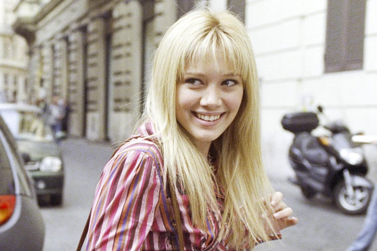 "Last we saw Lizzie (<a href=""https://ew.com/tag/hilary-duff/"">Hilary Duff</a>), she had just become an international pop star in <a href=""https://ew.com/creative-work/the-lizzie-mcguire-movie/""><em>The Lizzie McGuire Movie</em></a>. Who knows if that entire adventure will stay canon for the revival series? But regardless if she'll retain any kind of fame in her adult life, what can't be erased is the confidence she gained in Italy. She learned how to stand up for herself, face the world, and be herself in ways she never had before during her preteen and teen years on <em>Lizzie McGuire</em>.  Plus, she discovered she had feelings for her BFF Gordo (Adam Lamberg), and they ended up sharing a sweet, nervous, happy kiss on the roof of the hotel at the end of the movie. Lizzie may be engaged to a new, as-yet-to-be-revealed guy who isn't Gordo in the revival, but Lamberg is returning to reprise his role as Lizzie's BFF-turned-love-interest, so maybe their previous relationship isn't as over as Lizzie might think.  <a href=""https://ew.com/tv/2019/10/29/hilary-duff-first-look-lizzie-mcguire-revival-series-photos/"">RELATED: Hilary Duff shares first look photos at <em>Lizzie McGuire</em> revival series</a>"