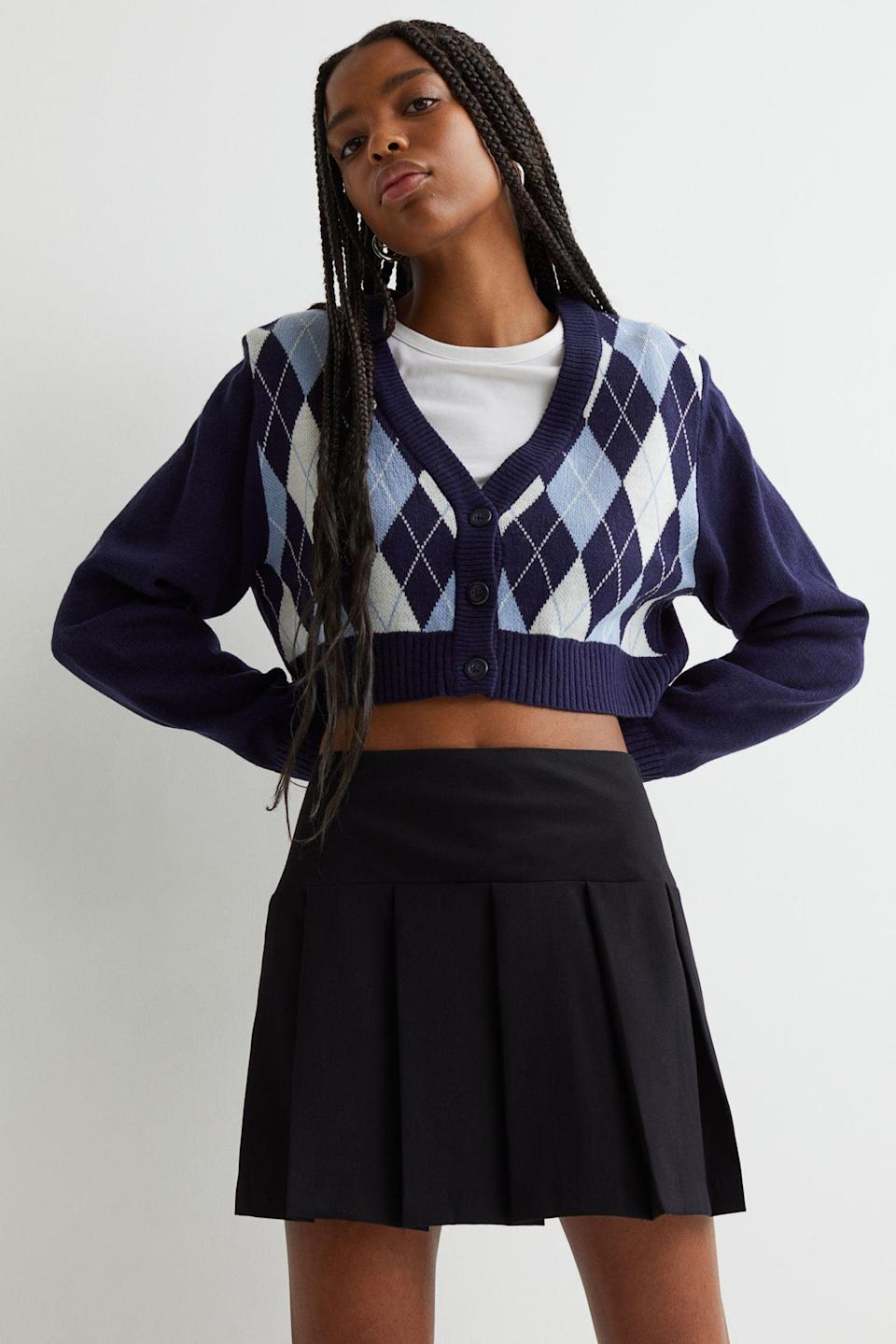 <p>This patterned <span>H&amp;M Short Cardigan</span> ($15, originally $18) is a great layering piece as temperatures start to dip. Throw it over a tank top or a tennis skirt ensemble, and you'll look effortlessly stylish.</p>