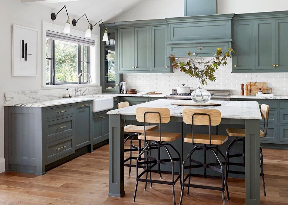 "The mid-1980s home was originally a one-story builder basic home that needed a rehaul and, according to Henderson, ""a big dose of soul."" She adds: ""It was originally pretty cheaply done and devoid of character and life."" Well, she definitely solved that problem because this kitchen is bursting with character. Congratulations Emily Henderson Design, we're completely smitten."
