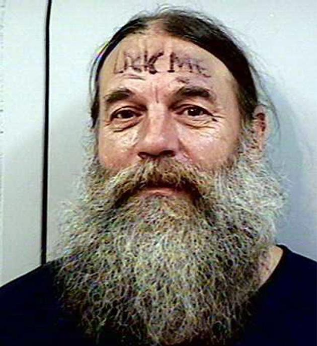 –Beareded Lance McKenzie, 49, from Oregon, US, has 'Lick Me' on his forehead. He served a 60-day sentence for assault (Rex Features)