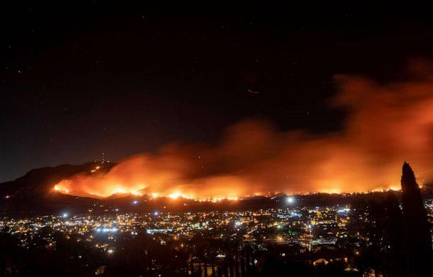 PHOTO: A long exposure photo shows the Maria fire as it races across a hillside in Santa Paula, Calif., Nov. 1, 2019. (Josh Edelson/AFP via Getty Images)