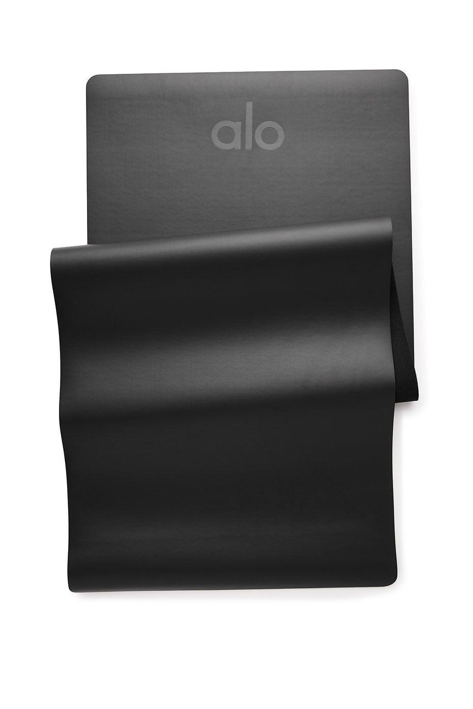 <p>I need to get some kind of movement in every day for my sanity, and this <span>Alo Warrior Mat</span> ($100) is a really sturdy option, where you won't slip out of downward dog. It's a wellness essential for me.</p>