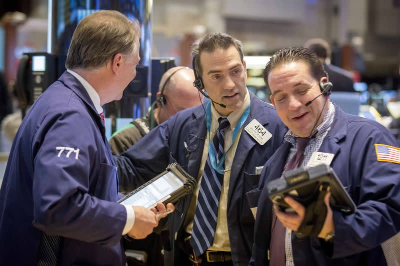 Traders works on the floor of the New York Stock Exchange