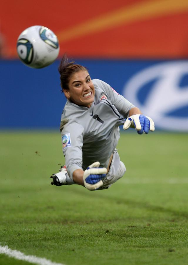 DRESDEN, GERMANY - JULY 10: Hope Solo of USA saves a penalty during the shoot out during the Women's World Cup Quarter Final match between Brazil and USA at Rudolf-Harbig Stadium on July 10, 2011 in Dresden, Germany. (Photo by Scott Heavey/Getty Images)