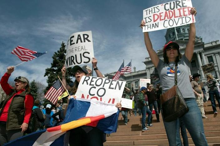 Demonstrators gather in front of the Colorado state capitol to protest coronavirus-related stay-at-home restrictions during a rally in Denver on April 19, 2020 (AFP Photo/Jason Connolly)