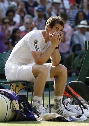 Andy Murray of Britain reacts before the trophy presentation after defeating Novak Djokovic of Serbia during the Men's singles final match at the All England Lawn Tennis Championships in Wimbledon, London, Sunday, July 7, 2013. (AP Photo/Kirsty Wigglesworth)