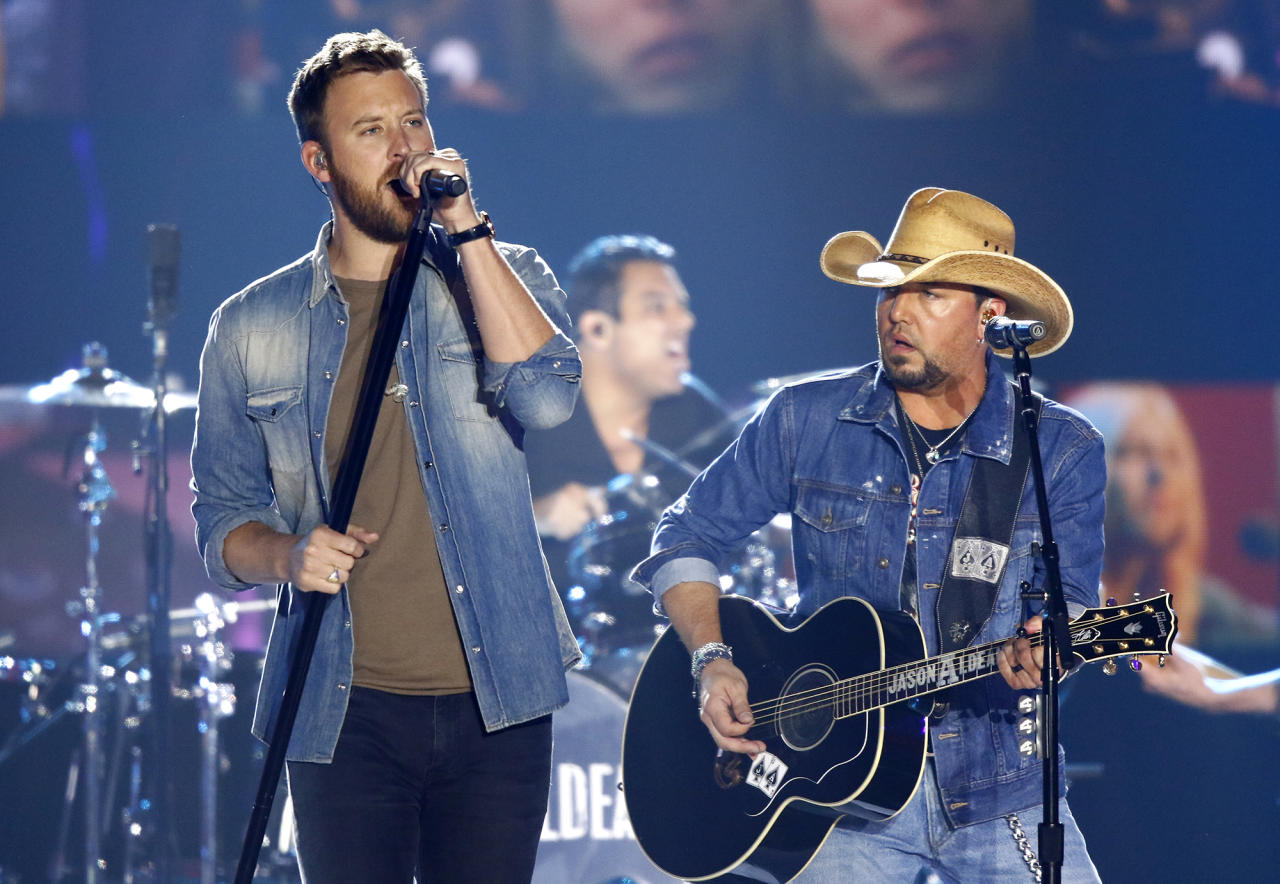"<p>Charles Kelley, left, and Jason Aldean perform ""Midnight Rider"" during a tribute to Greg Allman at the CMT Music Awards at Music City Center on Wednesday, June 7, 2017, in Nashville, Tenn. (Photo by Wade Payne/Invision/AP) </p>"