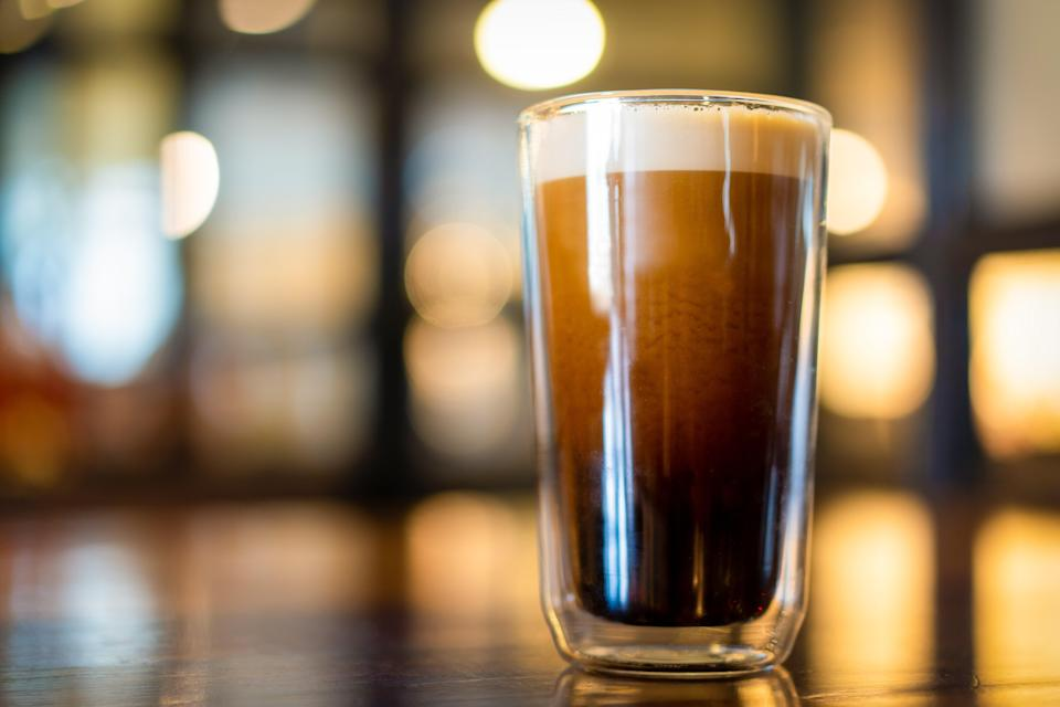 """<p>It seems that cold brew has become the caffeinated drink of choice in the U.S. in the past few years. That $5-a-pop price point is worth it for the chocolatey richness and upgrade from iced coffee. <em>Nitro</em> cold brew adds some extra flair—the coffee is infused with nitrogen, giving it a velvety, creamy, foamy texture, not unlike a Guinness. Unless you have some fairly heavy duty equipment it's a little tricky to pull of at home, but in a completely American fashion, it comes conveniently canned, shipped straight to your front door.</p> <p><strong>Try it at home:</strong> <a href=""""https://fave.co/3cjHnki"""" rel=""""nofollow noopener"""" target=""""_blank"""" data-ylk=""""slk:$29 RISE Nitro Cold Brew 12-pack, walmart.com"""" class=""""link rapid-noclick-resp"""">$29 RISE Nitro Cold Brew 12-pack, walmart.com</a></p>"""