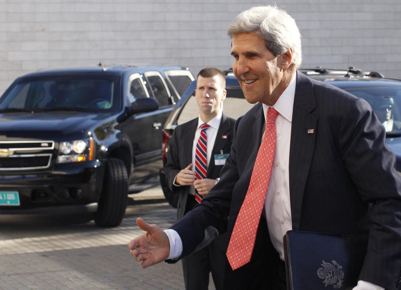 United States Secretary of State John Kerry arrives for an informal meeting of EU ministers for foreign affairs in the National Art Gallery in Vilnius, Lithuania, Saturday, Sept. 7, 2013. Kerry is in Europe courting international support for a possible U.S. strike on the Syrian regime for its alleged use of chemical weapons. (AP Photo/Mindaugas Kulbis)
