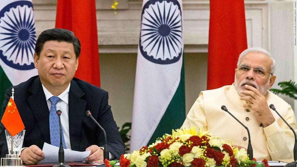 """<p>Narendra Modi, India's prime minister, right, and Xi Jinping, China's president, attend a meeting to sign a series of agreements between the two nations at Hyderabad House in New Delhi, India, on Thursday, Sept. 18, 2014. Modi won a pledge from Xi to invest $20 billion as the leaders sought to adjust a lopsided trade relationship and resolve a decades-long border dispute. Photographer Graham Crouch/Bloomberg via Getty Images </p><div class=""""cnn--image__credit""""><em><small>Credit: Graham Crouch/Bloomberg/Getty Images / Bloomberg via Getty Images</small></em></div>"""