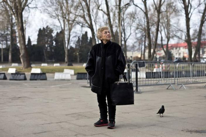 Jona Laks, survivor of Dr. Josef Mengele's twins experiments stands near the entrance to the Auschwitz death camp as she arrives for a visit with her granddaughter, in Oswiecim