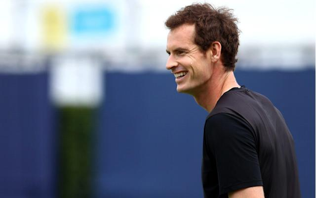 Andy Murray smiles during practice ahead of competing in the doubles competition at Queen's Club - Getty Images Europe