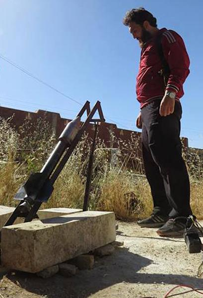 This citizen journalism image provided by Edlib News Network, ENN, which has been authenticated based on its contents and other AP reporting, shows a Syrian rebel preparing to fire a locally made rocket, in Idlib province, northern Syria, Tuesday, June 4, 2013. The Syrian government has denied it is facing a popular uprising since the revolt against Assad's rule erupted in March 2011, saying that the army is fighting foreign-backed terrorists who want to destroy the country. (AP Photo/Edlib News Network ENN)