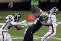 Atlanta Falcons quarterback Matt Ryan (2) is hit by New Orleans Saints outside linebacker Demario Davis (56) in the first half of an NFL football game in New Orleans, Sunday, Nov. 22, 2020. (AP Photo/Brett Duke)