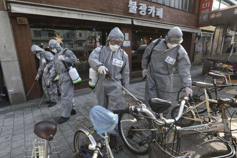 "South Korean army soldiers spray disinfectant as a precaution against the new coronavirus on a street in Seoul, South Korea, Friday, March 6, 2020. South Korea's premier has criticized Japan's 14-day quarantine on all visitors from South Korea due to its viral outbreak, demanding that Tokyo immediately withdraw the ""excessive and irrational measures."" (AP Photo/Ahn Young-joon)"