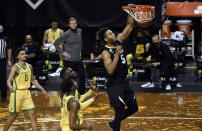 Colorado guard D'Shawn Schwartz (5) dunks as Oregon guard Will Richardson (0), center Franck Kepnang (22) and Oregon forward Chandler Lawson (13) trail during the first half of an NCAA college basketball game Thursday, Feb. 18, 2021, in Eugene, Ore. (AP Photo/Andy Nelson)