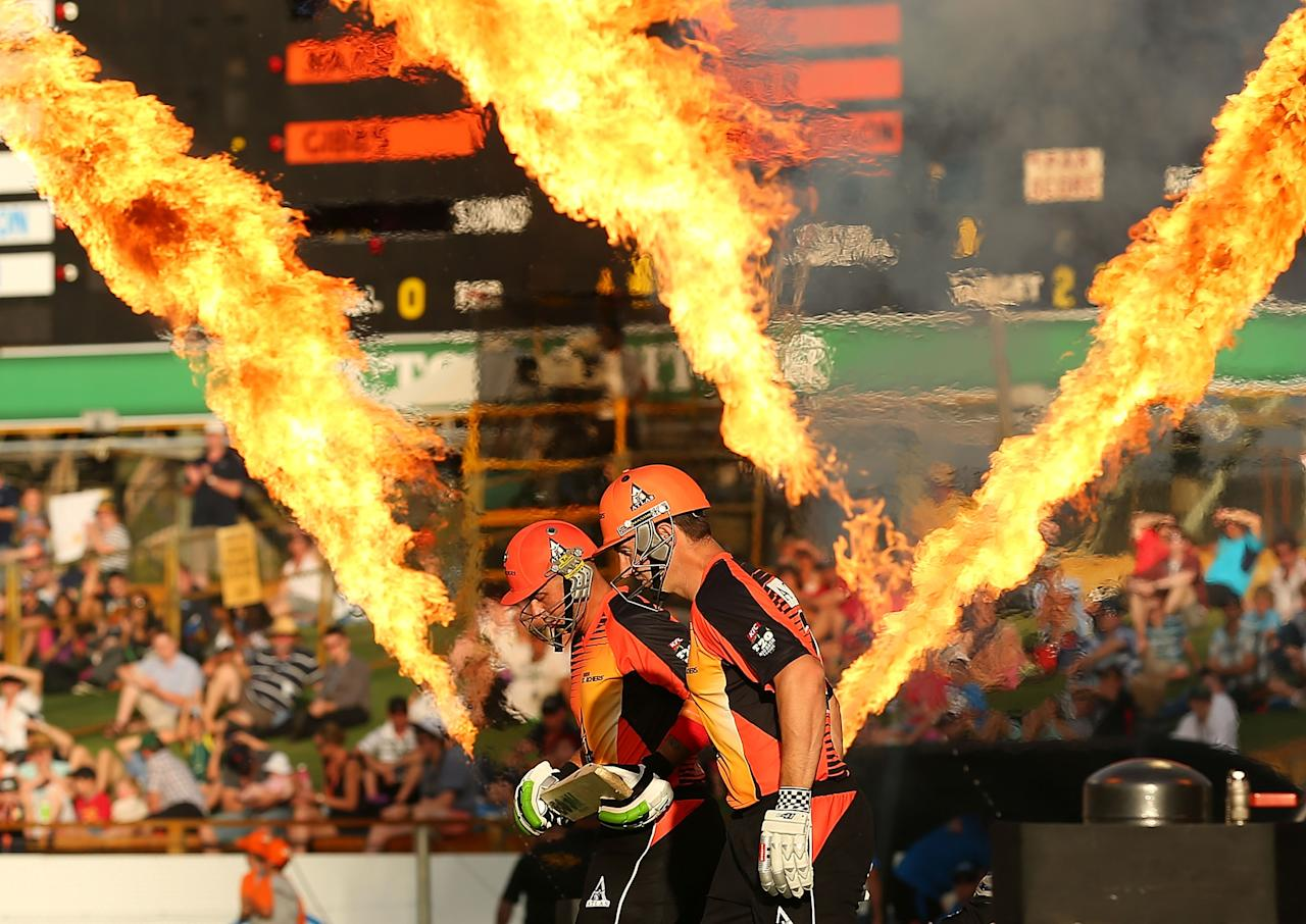 PERTH, AUSTRALIA - DECEMBER 09:  Herschelle Gibbs and Shaun Marsh of the Scorchers run onto the field during the Big Bash League match between the Perth Scorchers and Adelaide Strikers at WACA on December 9, 2012 in Perth, Australia.  (Photo by Paul Kane/Getty Images)