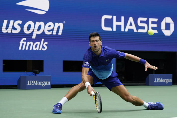 Novak Djokovic, of Serbia, returns a shot to Daniil Medvedev, of Russia, during the men's singles final of the US Open tennis championships, Sunday, Sept. 12, 2021, in New York. (AP Photo/Elise Amendola)