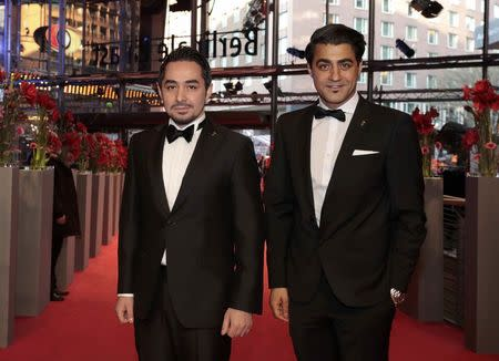 Actors Sherwan Haji (L) and Simon Hussein Al-Bazoon arrive for the screening of the movie 'The Other Side of Hope' at the 67th Berlinale International Film Festival in Berlin, February 14, 2017. REUTERS/Axel Schmidt