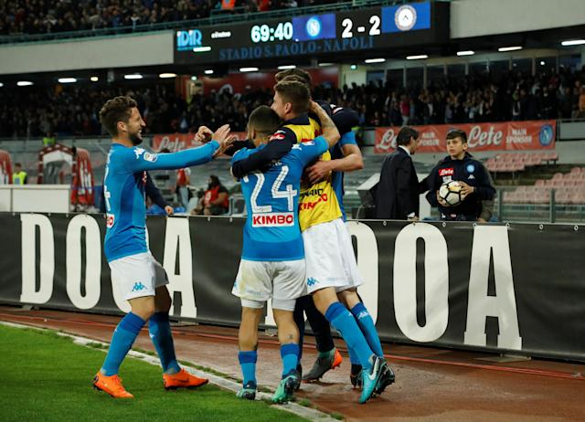 Soccer Football - Serie A - Napoli vs Udinese Calcio - Stadio San Paolo, Naples, Italy - April 18, 2018 Napoli's Arkadiusz Milik celebrates with team mates after scoring their third goal REUTERS/Ciro De Luca