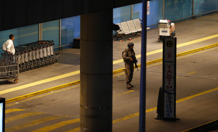 <p>Armed security walks at Turkey's largest airport, Istanbul Ataturk, Turkey, following a blast June 28, 2016. (REUTERS/Murad Sezer) </p>
