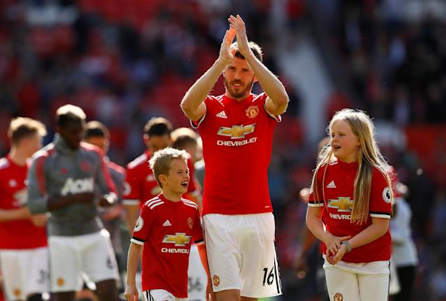 "Soccer Football - Premier League - Manchester United vs Watford - Old Trafford, Manchester, Britain - May 13, 2018 Manchester United's Michael Carrick applauds their fans alongside his children after the match Action Images via Reuters/Jason Cairnduff EDITORIAL USE ONLY. No use with unauthorized audio, video, data, fixture lists, club/league logos or ""live"" services. Online in-match use limited to 75 images, no video emulation. No use in betting, games or single club/league/player publications. Please contact your account representative for further details."