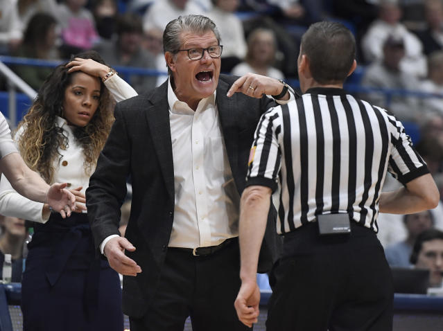Connecticut head coach Geno Auriemma reacts toward official Joseph Vaszily, right, as assistant coach Jasmine Lister, left, looks on, during the second half of an NCAA college basketball game against South Carolina, Monday, Feb. 11, 2019, in Hartford, Conn. (AP Photo/Jessica Hill)