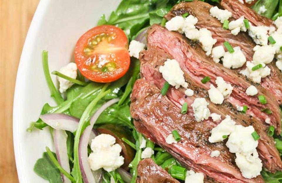 """<p>Love beef but looking to lower your calorie count? Try bison. Not only do bison steaks have fewer calories than their beef counterparts, but they're also rich in selenium, which can combat inflammation. Here, bison is served over a bed of arugula, tomatoes, red onion and bleu cheese.</p> <p><a href=""""https://www.thedailymeal.com/seared-bison-salad-recipe?referrer=yahoo&category=beauty_food&include_utm=1&utm_medium=referral&utm_source=yahoo&utm_campaign=feed"""" rel=""""nofollow noopener"""" target=""""_blank"""" data-ylk=""""slk:For the Seared Bison Salad recipe, click here."""" class=""""link rapid-noclick-resp"""">For the Seared Bison Salad recipe, click here.</a></p>"""