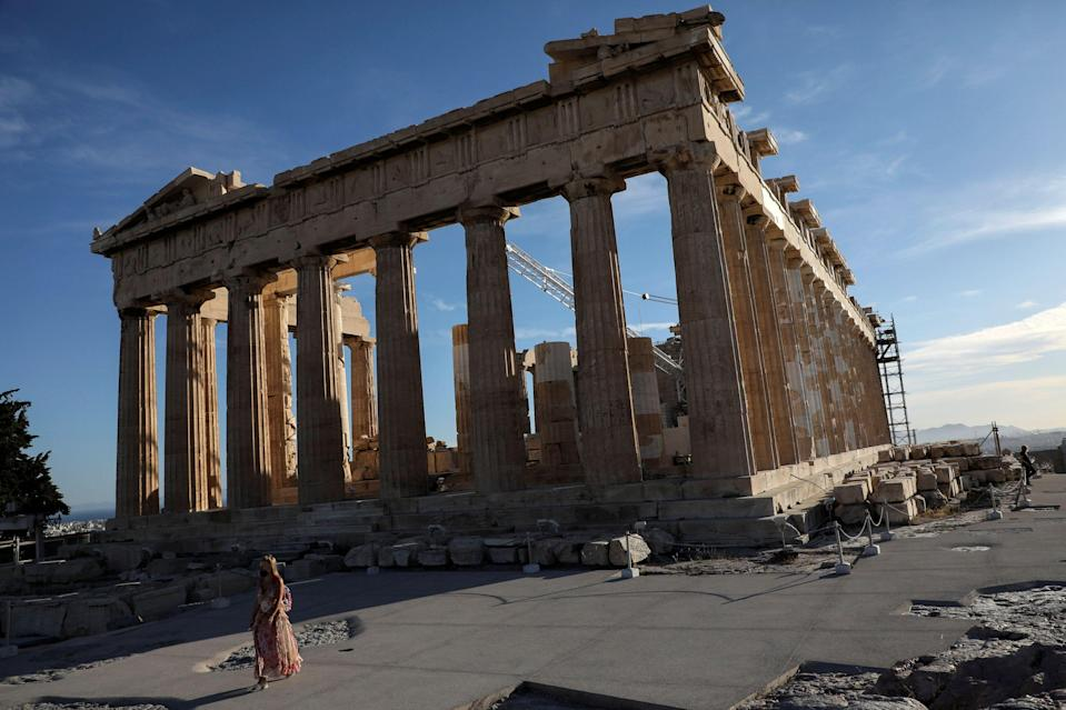 A woman wearing a protective face mask walks by the Parthenon temple atop the Acropolis hill, amid the spread of the coronavirus disease (COVID-19), in Athens, Greece, May 17, 2021. Picture taken May 17, 2021. REUTERS/Louiza Vradi (Photo: LOUIZA VRADI via REUTERS)