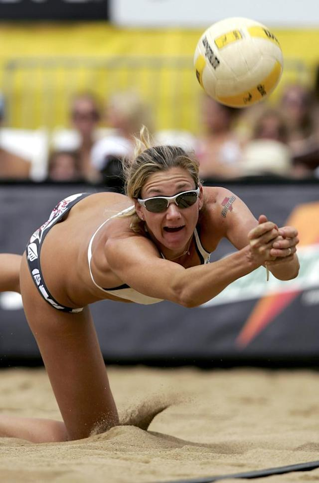Kerri Walsh digs the ball as she and Misty May-Treanor defeated Tammy Leibl and Dianne DeNecochea in their semifinal match in the AVP Cuervo Gold Crown Boulder Open at the Boulder Reservoir on August 27, 2006 in Boulder, Colorado. Kerri Walsh and Misty May-Turner went on to defeat Annett Davis and Jenny Johnson Jordan in the womens championship match.