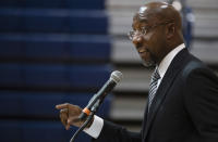 Sen. Raphael Warnock, D-Ga., speaks at Alfred E. Beach High School in Savannah, Ga., Thursday, July 8, 2021. Warnock joined fellow Democratic senators Jon Ossoff of Georgia and Tammy Baldwin of Wisconsin in introducing a bill on Monday, July 12, 2021, to require the federal government to set up a Medicaid-like health plan in states that have not expanded Medicaid plans to cover more low-income adults. (Jim Watson/Pool via AP)