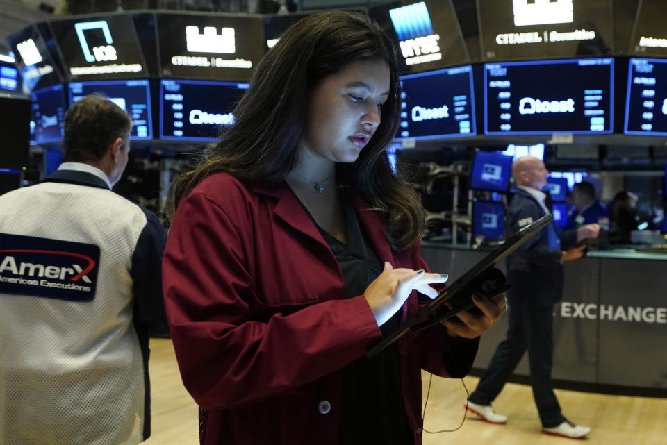 Trader Ashley Lara works on the floor of the New York Stock Exchange, Wednesday, Sept. 22, 2021. Stocks rose broadly on Wall Street Wednesday ahead of an update from the Federal Reserve on how and when it might begin easing its extraordinary support measures for the economy. (AP Photo/Richard Drew)