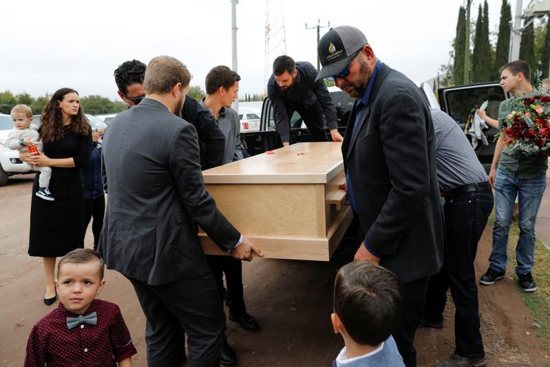 Relatives of Christina Marie Langford Johnson, who was killed by unknown assailants, carry her coffin during the funeral service before a burial at the cemetery in LeBaron, Chihuahua
