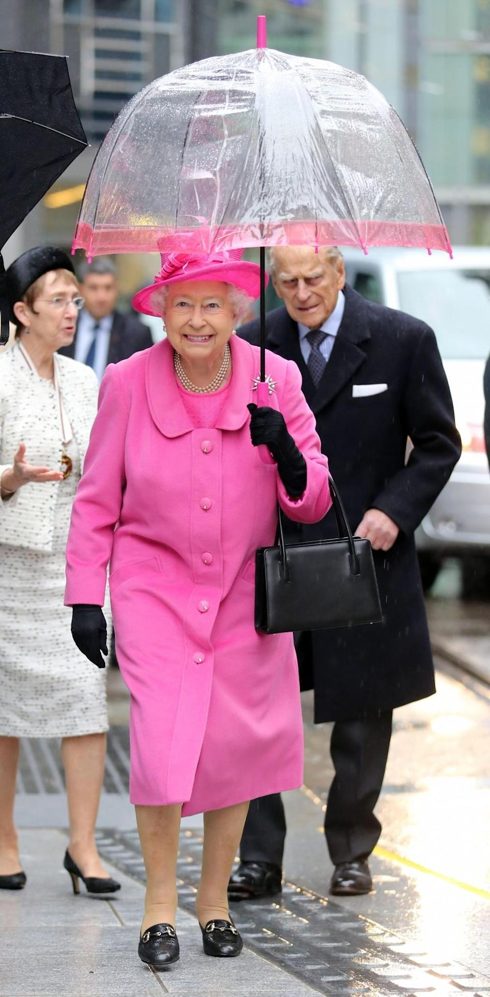 <p>You couldn't miss the Queen in this bright pink ensemble worn on a royal visit to Birmingham.<br><i>[Photo: PA]</i> </p>