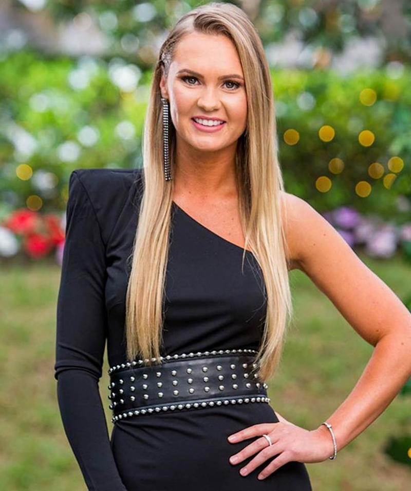 Chelsie McLeod in a one-sleeved back dress and a black belt on The Bachelor Australia 2019