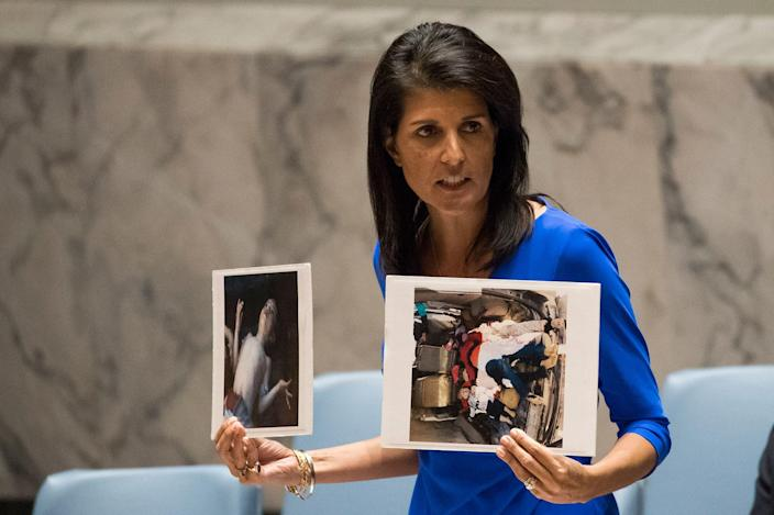 <p>APR. 5, 2017 – U.S. Ambassador to the United Nations Nikki Haley holds up photos of victims of the Syrian chemical attack during a meeting of the United Nations Security Council at U.N. headquarters, April 5, 2017 in New York City. The Security Council is held emergency talks following the worst use of chemical weapons in Syria since the Ghouta attack in 2013. (Photo: Drew Angerer/Getty Images) </p>