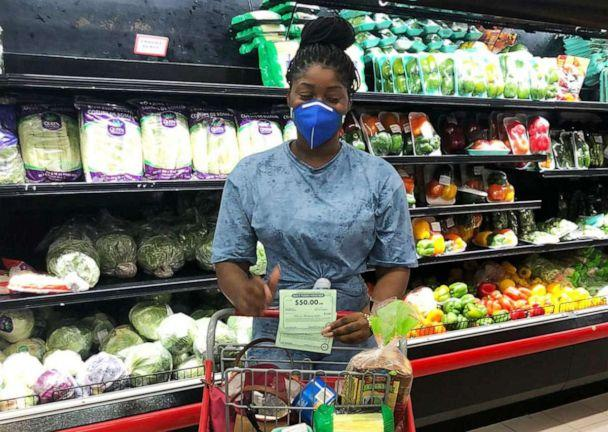 PHOTO: A woman shops using her COVID-19 Food Vouchers from the Blanchards Anguilla Children's Fund. (Blanchards Anguilla Children's Fund)