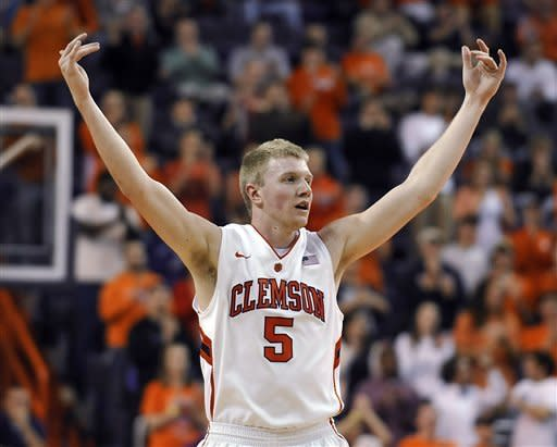 Clemson's Tanner Smith reacts after his team scored during the second half of an NCAA college basketball game against Virginia on Tuesday, Feb. 14, 2012, in Clemson, S.C. Clemson won 60-48. (AP Photo/Rainier Ehrhardt)